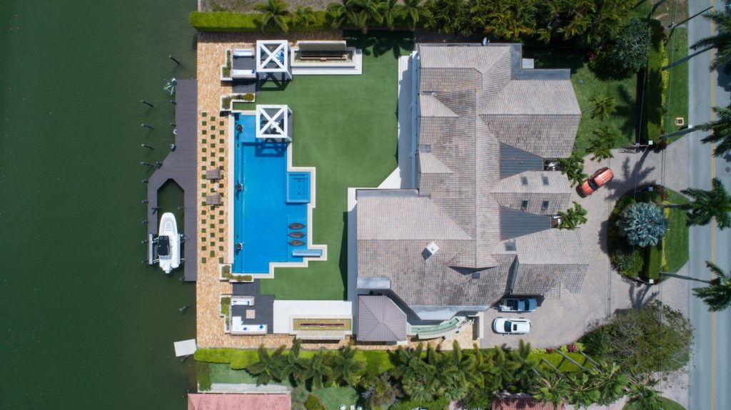 aerial drone photograph of home with swimming pool