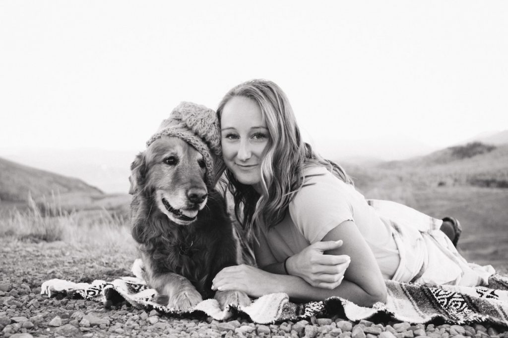 photo of a woman and a dog wearing a hat